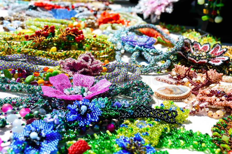 Selling beautiful colorful women`s jewelry from beads. Fair - an exhibition of folk craftsmen royalty free stock image