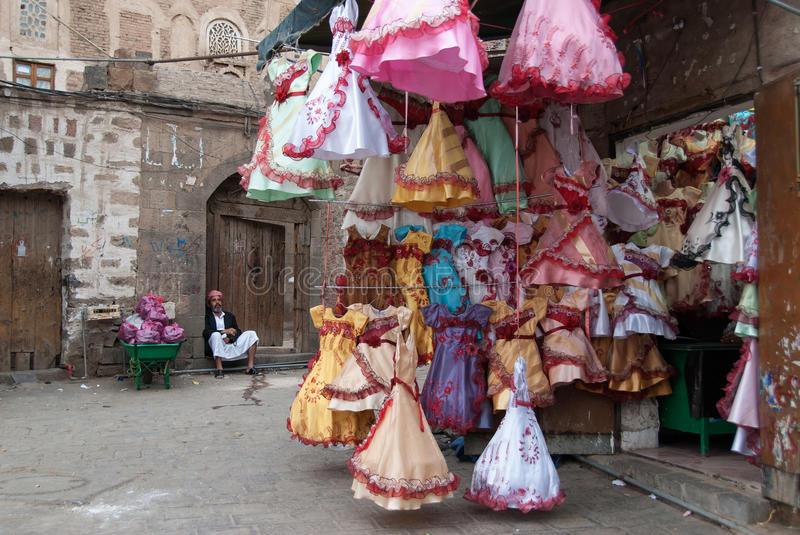 Selling dresses in Yemen. An unidentified man sells colorful dresses for girls on May 4, 2007 in Sanaa, Yemen stock photo