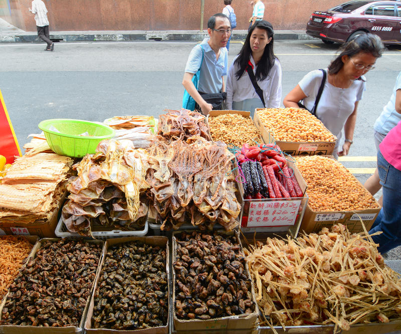 Selling dried herbal and dried food at Chinatown. Singapore - Oct 3, 2015. People buy dried herbal and dried food at Chinatown of Singapore. It is a traditional stock photos