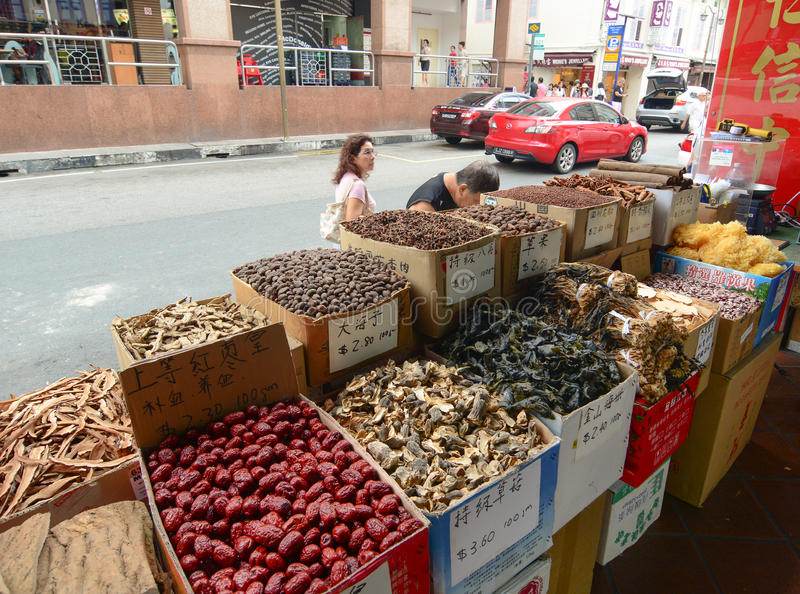 Selling dried herbal and dried food at Chinatown. Singapore - Oct 3, 2015. Selling dried herbal and dried food on the street in Chinatown of Singapore. It is a stock photo