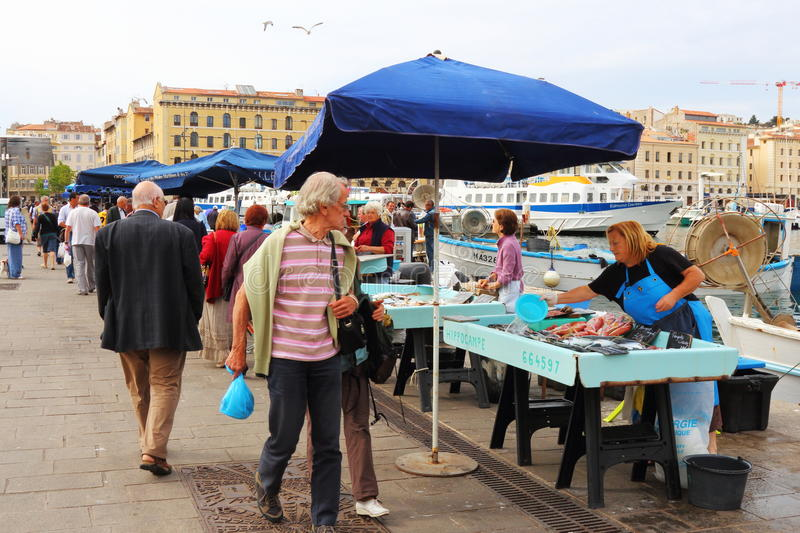 Selling fish at market, Marseille Port, France stock photos