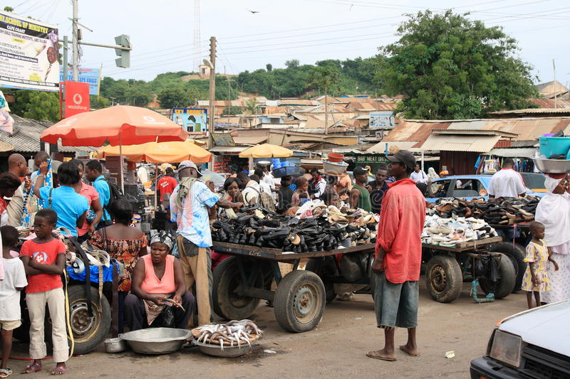 Selling fish and shoes on African street market stock photo