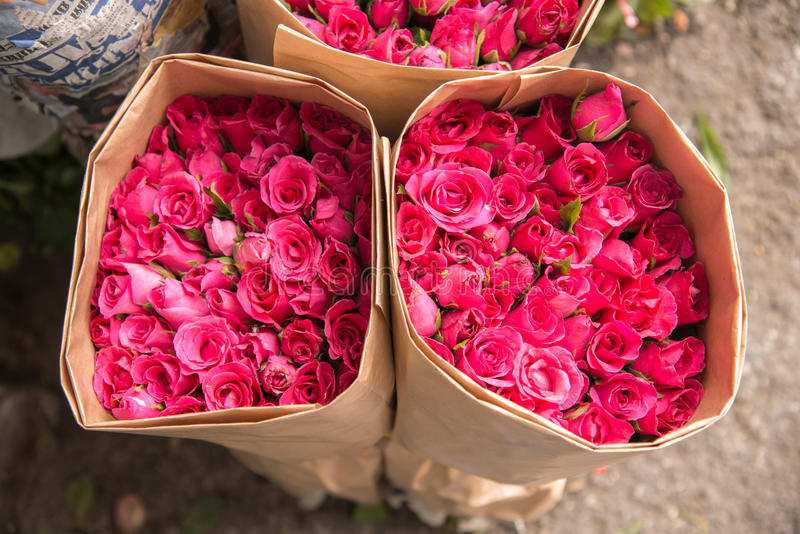 Selling flowers a bouquet of red pink roses wrapped in paper download selling flowers a bouquet of red pink roses wrapped in paper stock image mightylinksfo