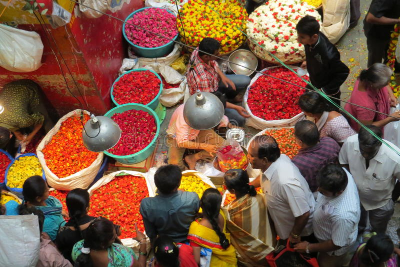 Selling flowers at KR market in Bangalore. Colorful flowers on sale in Bangalore's famous KR flower market stock photo