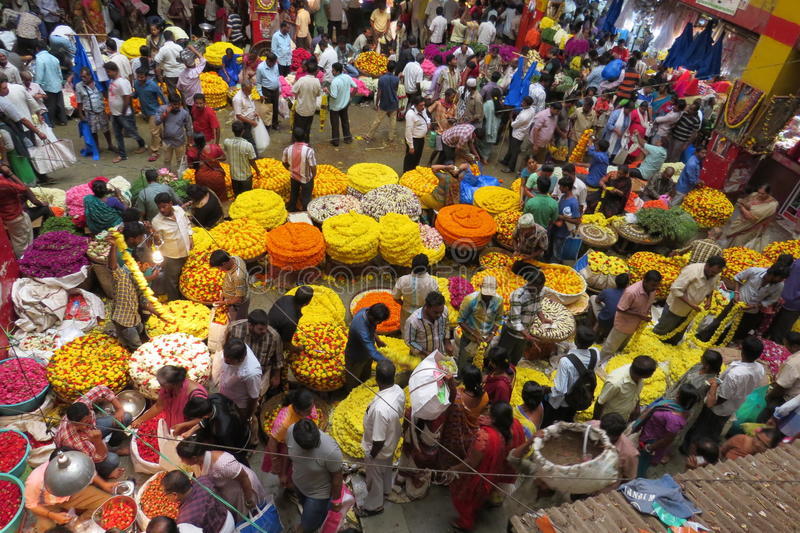 Selling flowers at KR market in Bangalore. Crowded scene in the market in Bangalore royalty free stock images