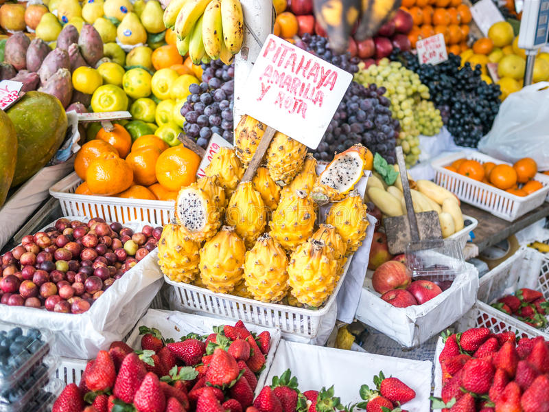 Selling Pitahaya. A little store in Mercado de Surquillo market selling the typical peruvian Pitahaya (Text translation: Pitahaya yellow and red royalty free stock photography
