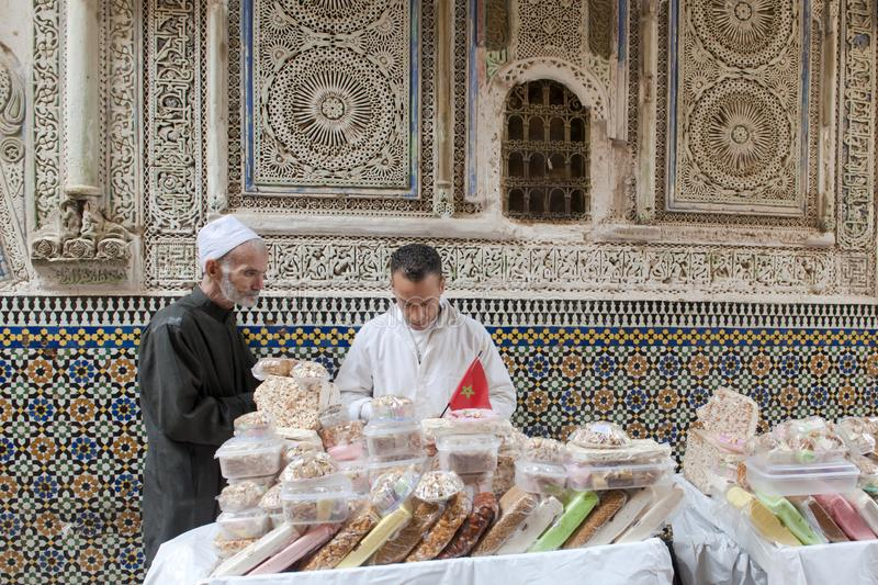 Selling white nougat in front of a mosque, Fez, Morocco royalty free stock images
