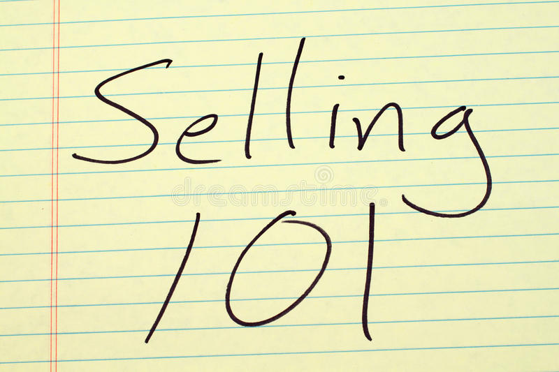Selling 101 On A Yellow Legal Pad royalty free stock photo
