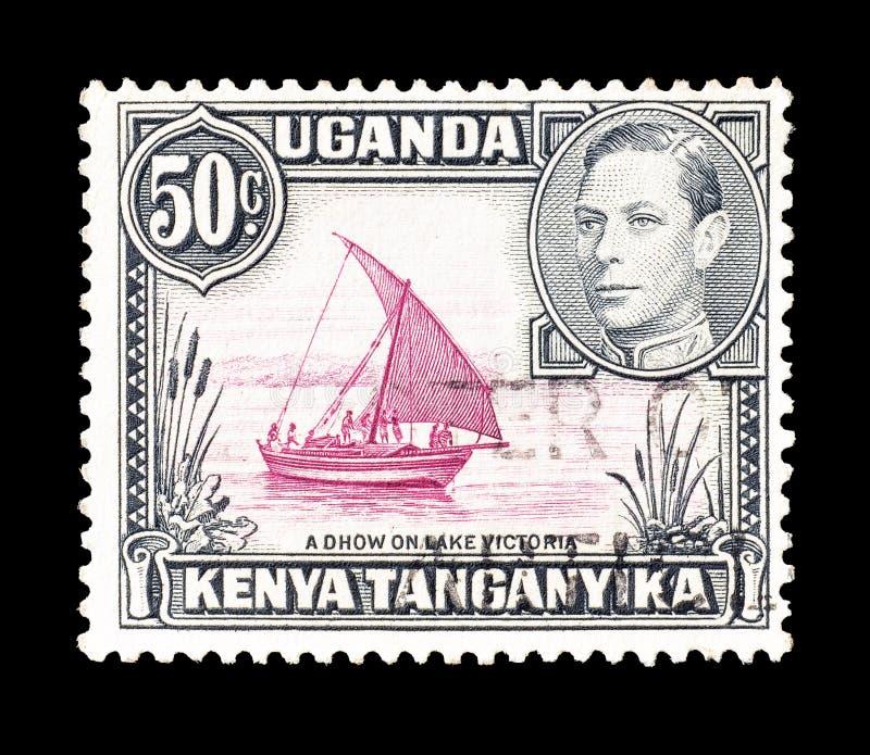 Sello cancelado impreso por el Uganda, el Kenia y el Tanganyika fotos de archivo