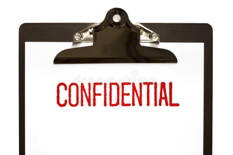 Sello confidencial en el sujetapapeles imagen de archivo libre de regalías