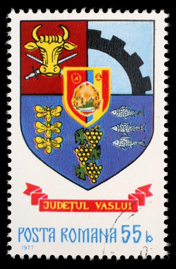 Sello impreso en Rumania, escudo de armas de las demostraciones del condado de Vaslui foto de archivo