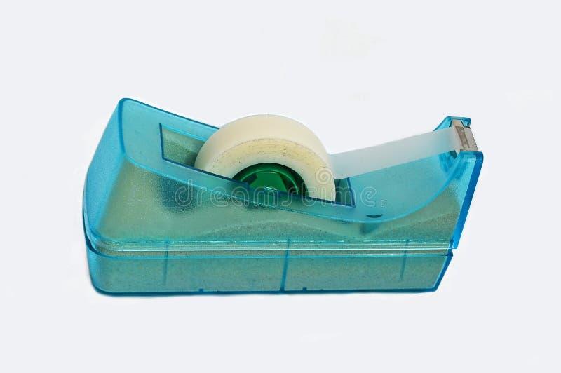 Sellotape Dispenser. A roll of sticky tape in a dispenser stock photo