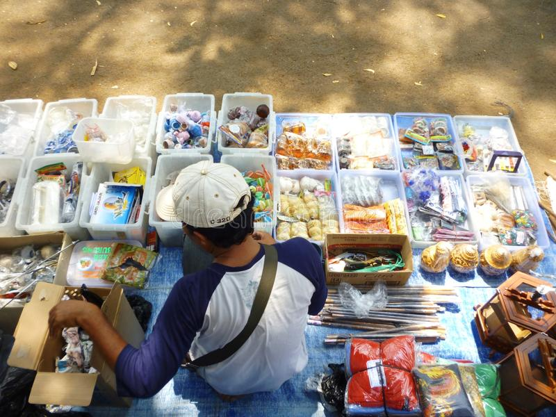 Sells equipment for caring the birds. Man sells equipment for caring the birds in Pati, Indonesia stock image