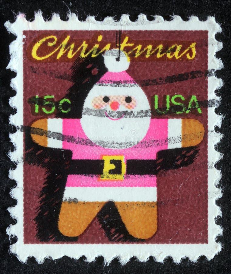 Selo do Natal impresso nos EUA que mostram Santa Claus fotografia de stock royalty free