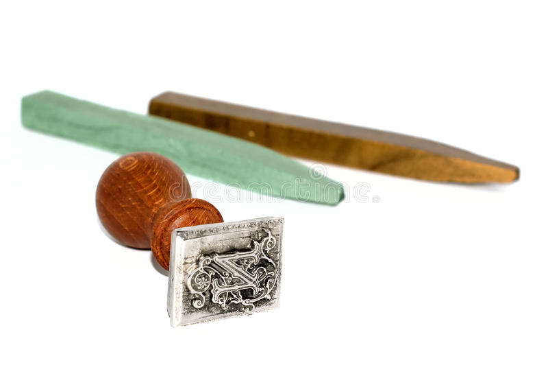Selo e cera de selagem no fundo branco fotos de stock