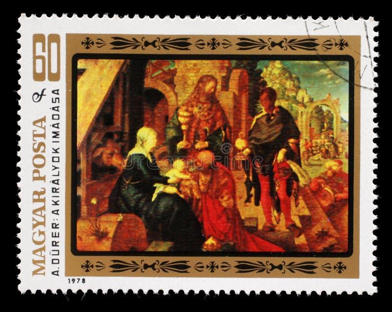 Selo impresso em Hungria, mostras uma imagem da adoração do ` de Albrecht Durer do artista do ` dos três Reis Magos fotografia de stock royalty free