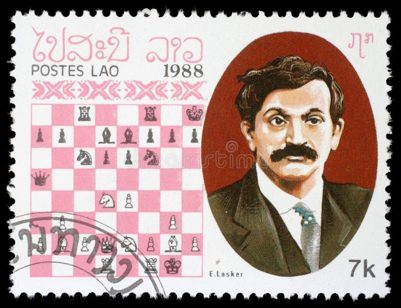Selo impresso em Laos, mostras E Lasker, campeão da xadrez imagens de stock