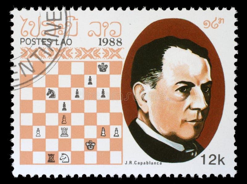 Selo impresso em Laos, mostras J r Capablanca, campeão da xadrez fotografia de stock royalty free