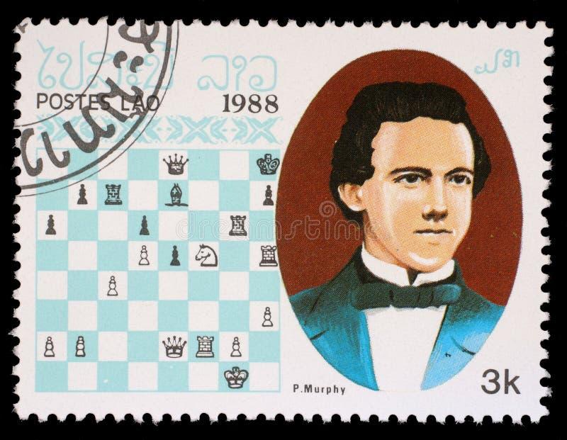 Selo impresso em Laos, mostras P Murphy, campeão da xadrez imagens de stock