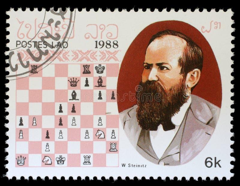 Selo impresso em Laos, mostras W Steinitz, campeão da xadrez fotos de stock royalty free