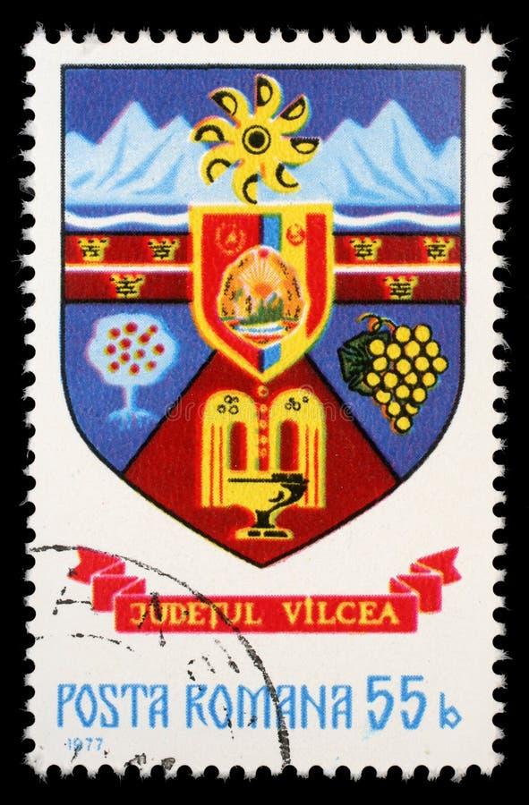 Selo impresso em Romênia, brasão das mostras do condado de Vilcea imagens de stock royalty free
