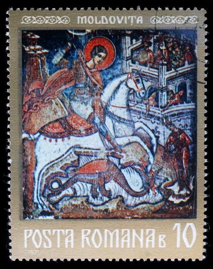 Selo impresso em Romênia, mostras um fresco de St George, monastério de Moldovita fotografia de stock royalty free