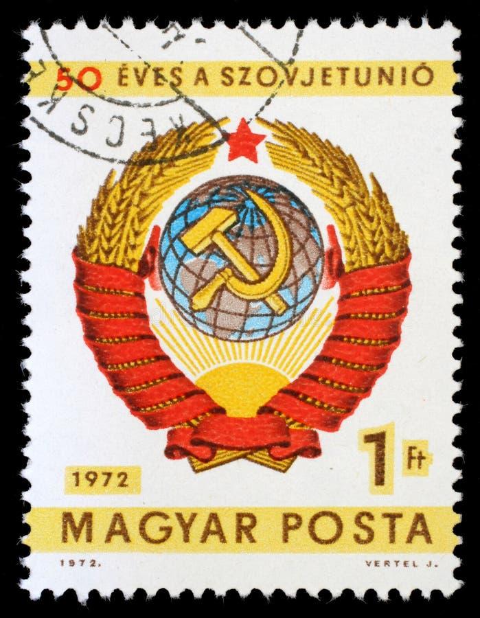 Selo impresso por Hungria, braços das mostras de União Soviética fotografia de stock royalty free