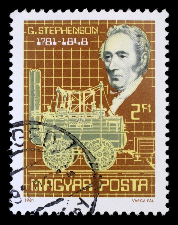 Selo impresso por Hungria, por mostras George Stephenson e por sua locomotiva de vapor fotos de stock royalty free
