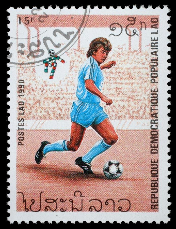 Selo impresso por Laos, campeonatos do futebol das mostras fotografia de stock