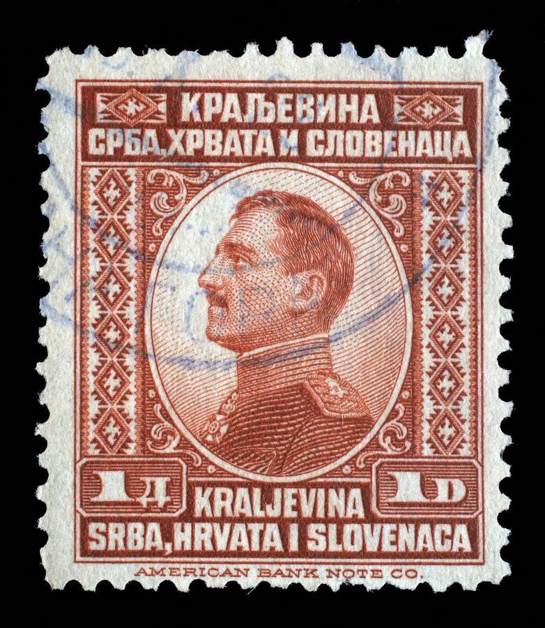 Selo impresso retrato nas mostras da Sérvia, da Croácia e do Eslovênia do reino de Jugoslávia do rei Alexander Eu de Jugoslávia fotos de stock