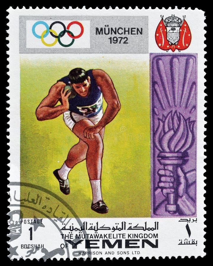 Selo postal cancelado impresso por Iémen fotos de stock