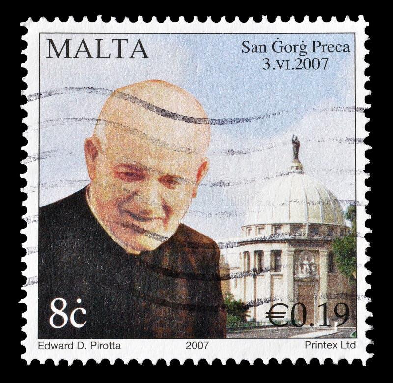 Selo postal cancelado impresso por Malta fotos de stock