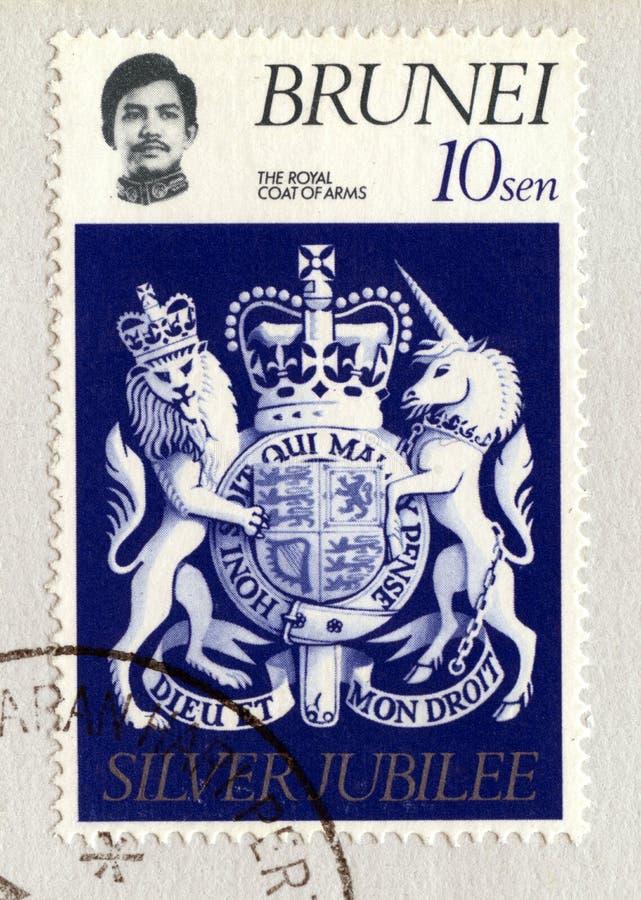 Selo postal de Brunei Darussalam que comemora o jubileu de prata do ` s da rainha foto de stock royalty free