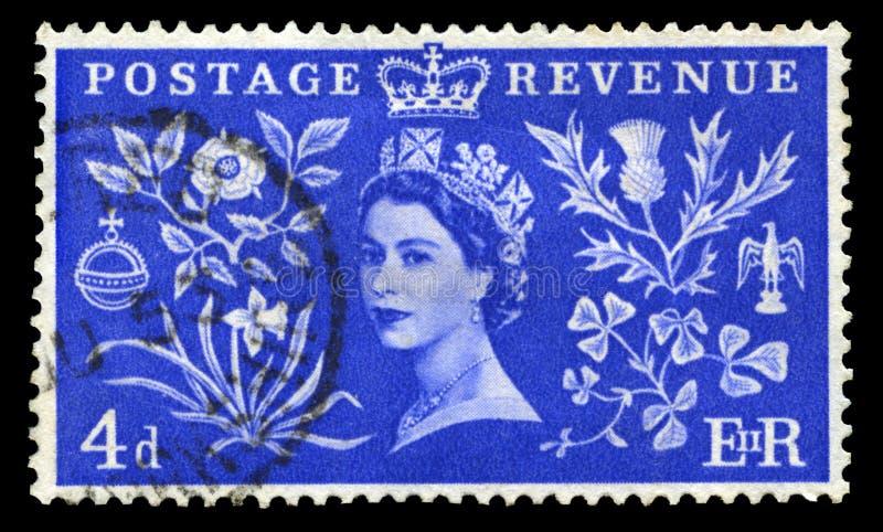 Selo postal do vintage que comemora a coroação do ` s da rainha imagens de stock royalty free