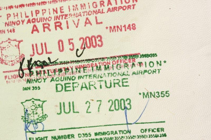 Selos do passaporte da partida da chegada imagens de stock