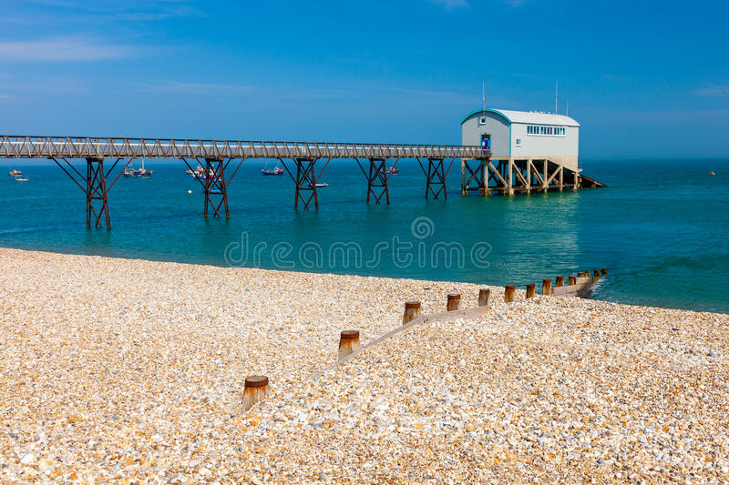 Selsey Bill West Sussex England. Selsey Bill beach with the lifeboat station in the background. West Sussex England UK Europe royalty free stock photos