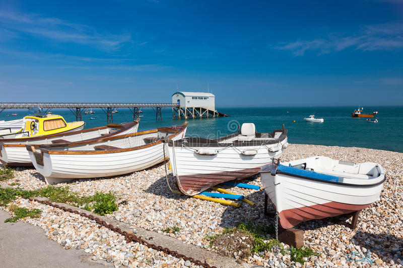 Selsey Bill West Sussex England. Boats on the shingle beach at Selsey Bill West Sussex England UK Europe stock photo