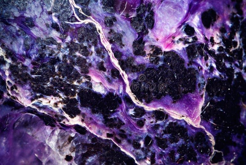 Seltenes Mineralcharoit, stockbild