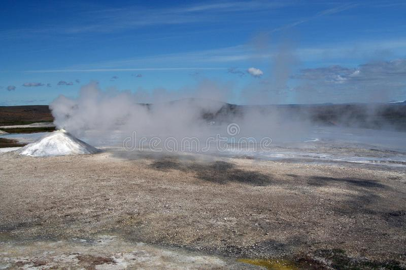 Seltun / Krysuvik Krýsuvík bubbling and steaming geothermal area. Fumarole emit steam under blue sky in geothermal area - Iceland stock images