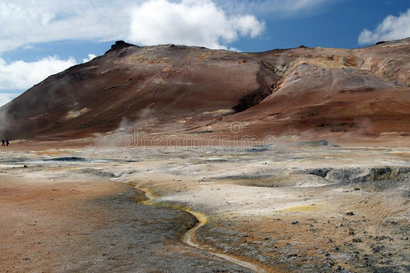 Seltun / Krysuvik Krýsuvík: Road through red hills leading to yellow and white geothermal valley. Road through red hills leading to yellow and white royalty free stock photo