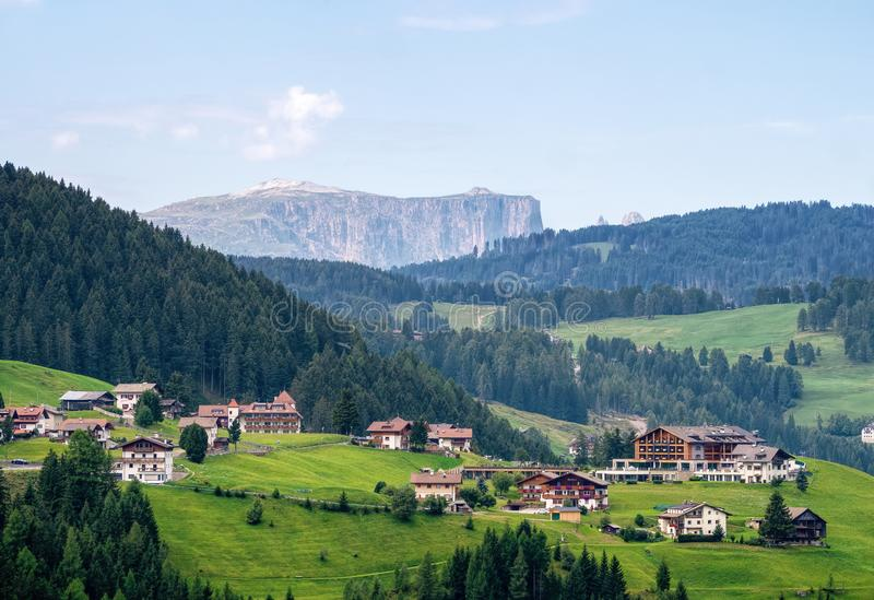 SELVA GARDENA, ITALY- SEPTEMBER 1, 2019: View across the town to the Sciliar Schlern mountain in the Dolomites. stock image