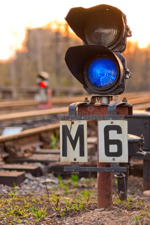 Semaphore on railway lit blue light. A semaphore on railway lit blue light stock photo