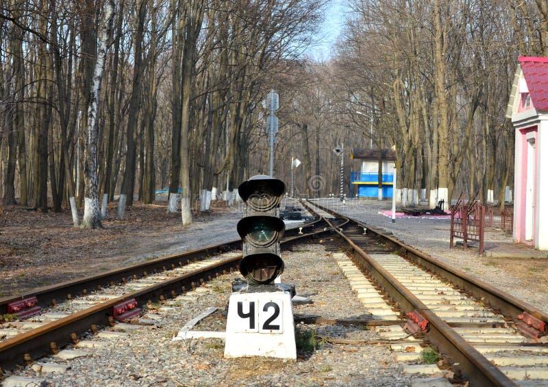 Semaphore on the railway, rails that go into the distance. The semaphore on the railway, the rails that go into the distance, the railway in the forest stock photography