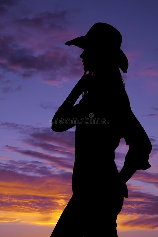 Sembler la cow-girl latérale de silhouette image stock