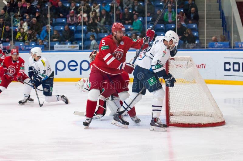 A. Semenov (5) vs B. Segal (12). MOSCOW - JANUARY 10: A. Semenov (5) fight with B. Segal (12) on hockey game Vityaz vs Medvezchak on Russian KHL premier hockey royalty free stock image