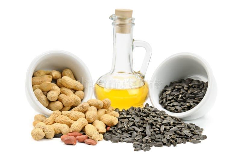 Sementes, amendoins e petróleo de girassol imagem de stock