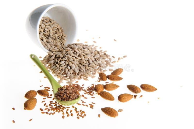 Sementes de linho, sementes de girassol, amêndoas foto de stock