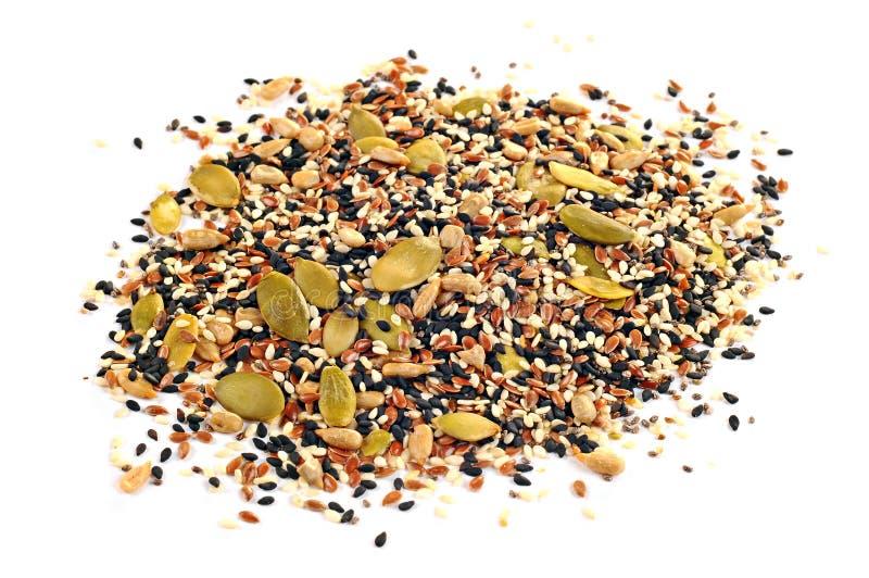 Sementes de sementes de linho, de sementes de girassol, de sésamo, de chia e de abóbora no fundo branco imagens de stock royalty free