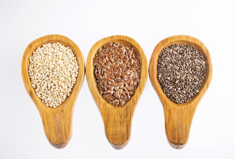 Sementes orgânicas do Quinoa, o Flaxseed e o Chia - o Superfoods imagem de stock royalty free