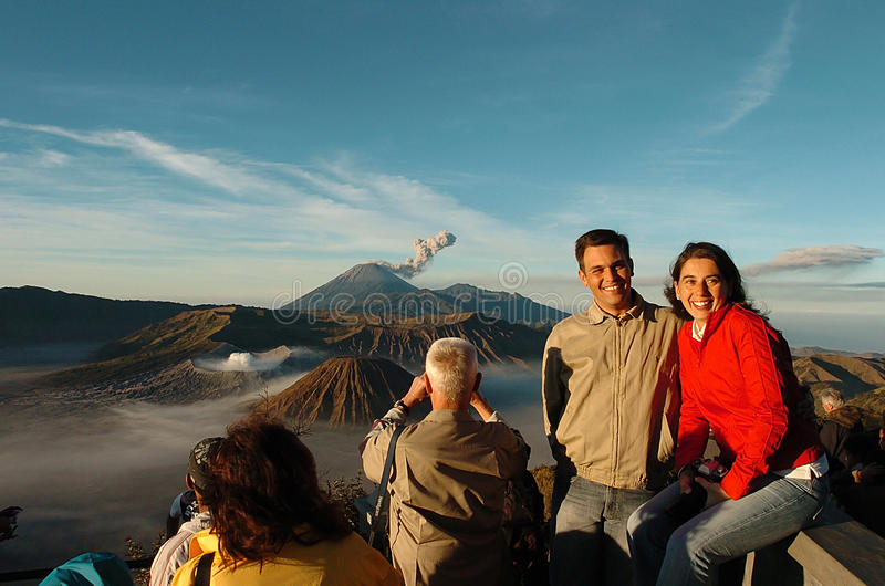 Semeru. EAST JAVA, INDONESIA - August 27, 2007: Travelers pose with the background of the beauty of Mount Bromo, East Java, Indonesia. Photo taken August 27th stock images